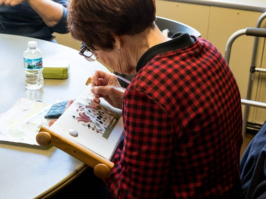 Embroidery Guild member Jean McKenzie Farmington Hills works on an embroidery project at the Costick Center in Farmington Hills on Friday, October 4, 2019.
