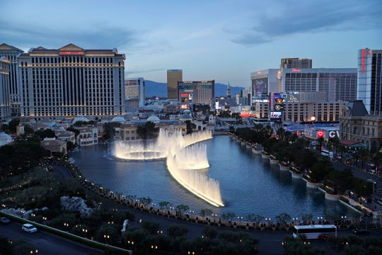FILE - In this April 4, 2017, file photo, the fountains of Bellagio erupt along the Las Vegas Strip in Las Vegas. MGM Resorts International announced the sale Tuesday, Oct. 15, 2019, of two casinos that will significantly alter its portfolio of Las Vegas Strip properties and offer up cash.