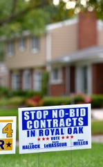 'Stop No-Bid Contracts' is one of several yard signs on display in front of a residence on Auburn Drive in Royal Oak.