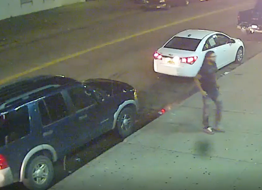 Detroit police say a man in a blue SUV entered the liquor store and threw a bottle at a flat screen TV.