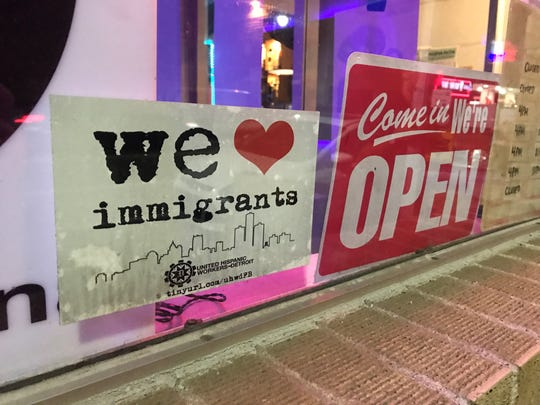 A sign welcoming immigrants at Pizza Plex in southwest Detroit.