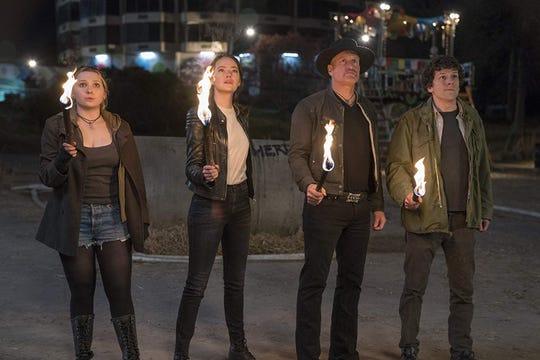"Abigail Breslin, Emma Stone, Woody Harrelson and Jesse Eisenberg in ""Zombieland: Double Tap."""