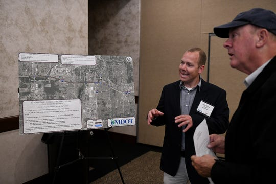 MDOT project manager Jeff Horne talks with Canton resident Gordon Andersen,  right, at an open house style meeting by MDOT talking about the upcoming I-275 roadwork planned for the spring through fall of 2020. The meeting was at Summit on the Park in Canton, Mich. on Oct. 15, 2019.