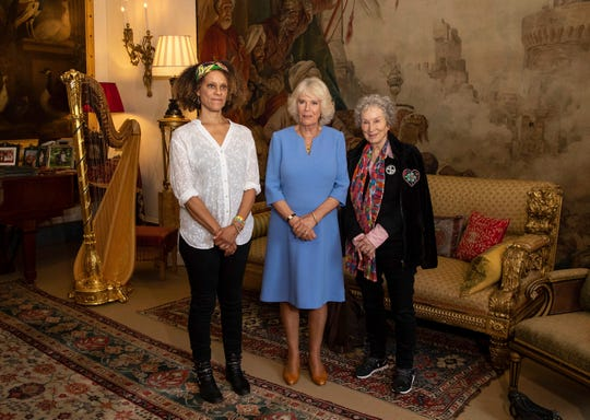 Britain's Camila The Duchess of Cornwall poses for photographs with 2019 Booker prize joint winners Margaret Atwood, right, and Bernardine Evaristo, left, during a reception for the Booker Prize Foundation at Clarence House in London, Tuesday Oct. 15, 2019.