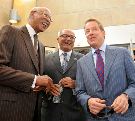Then Detroit Mayor Dave Bing, left, Ford Motor Company Fund and Community Services President Jim Vella and Ford Motor Co. Executive Chairman Bill Ford Jr. greet one another during the opening of the Ford Engagement Center at the Mexicantown Mercado on June 7, 2013.