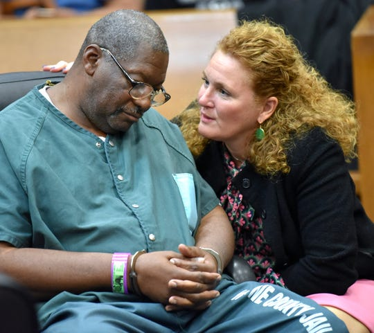 Juvenile lifer Charles Lewis listens to mitigation specialist Jessica Carrier during his hearing on whether he will be set free or get a new trial in the murder of an off-duty police officer in 1976. Wayne County Circuit Court Judge Quina Lillard presided over the case Tuesday, October 15, 2019 in Detroit.