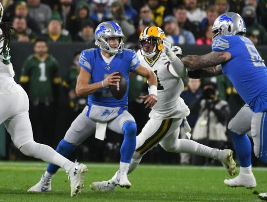 Lions quarterback Matthew Stafford takes off and runs for a first down in the first quarter.