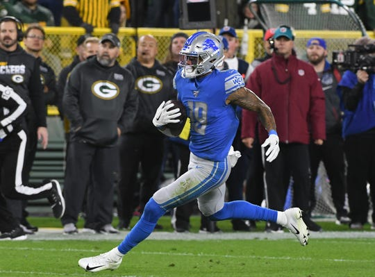 Lions receiver Kenny Golladay catches a ball in stride and runs out a first down in the second quarter.