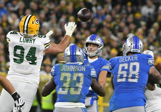 Lions quarterback Matthew Stafford throws a pass in the first quarter.