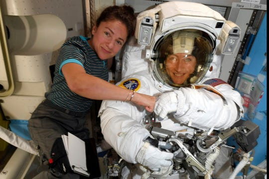 Astronauts Christina Koch, right, and, Jessica Meir on the International Space Station. NASA has moved up the first all-female spacewalk to Thursday, Oct. 17, 2019, or Friday because of a power system failure at the International Space Station.