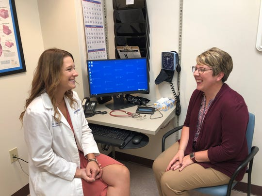 Melissa Cantellops, FNP, left, and Randi Randall discuss Randi's individualized plan for breast screening at the Guthrie High Risk Breast Cancer Clinic.