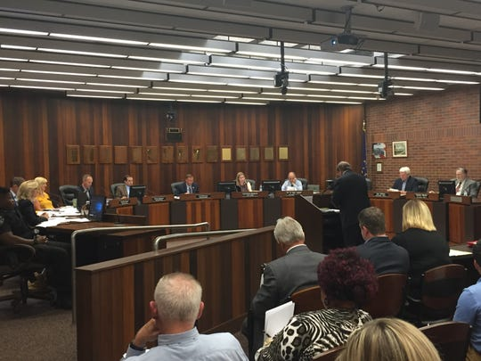 The Evansville City Council on Monday passed city government's 2020 budget but debate how to handle a seven-figure hospitalization debt.