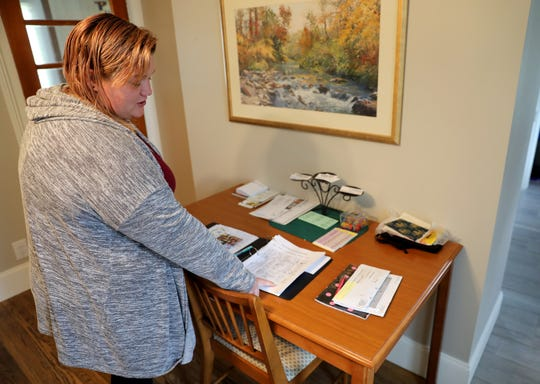 Women with opioid addictions can live a sober life at Recovery Pathways Opportunity House in Dodgeville, Wis. the sole sober-living house in the county.  Here, Jessica Shepherd points to a book where residents check in and out. Shepherd was addicted to opioids and methamphetamine, and says meth use is common in southwestern Wisconsin. Only those with opioid addictions can live at the house — a restriction health officials and service providers say is hindering their ability to treat addiction. Shepherd says the cravings for meth are intense and very hard to escape. In some ways, meth is more difficult to treat than opioids. Long-term care is especially important to treat meth addiction, but providers say there is a shortage of these sorts of services in the state. Photo taken Oct. 3, 2019.