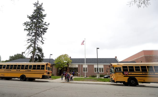 Students leave school on Thursday, Oct. 3, 2019, at Jefferson Elementary School in Green Bay.