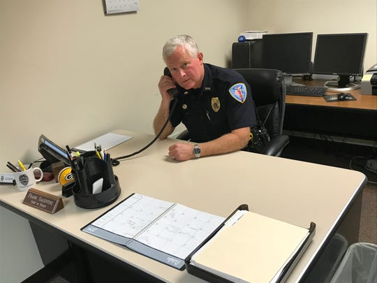 Kewaunee Police Chief Frank Salentine, taking a call at his desk, is retiring Oct. 19 after 20 years as chief and 32 with the department.