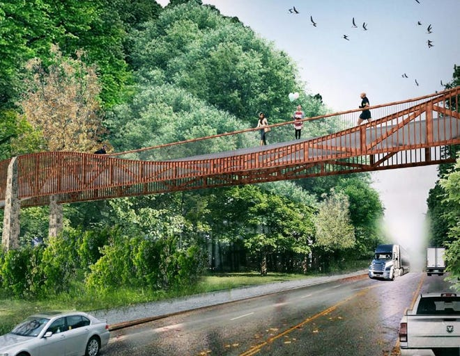 An example of how a Swamp Rabbit Trail bridge over Verdae Boulevard might look.