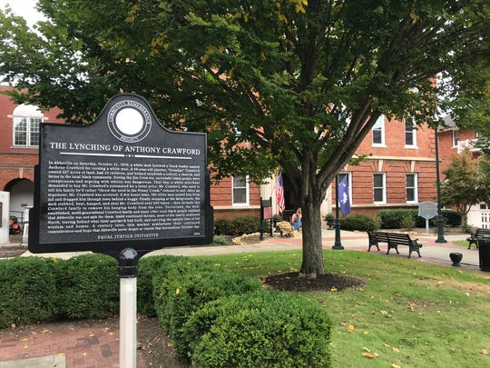 In Abbeville, a historic marker tells the story of the 1916 lynching of a planter named Anthony Crawford