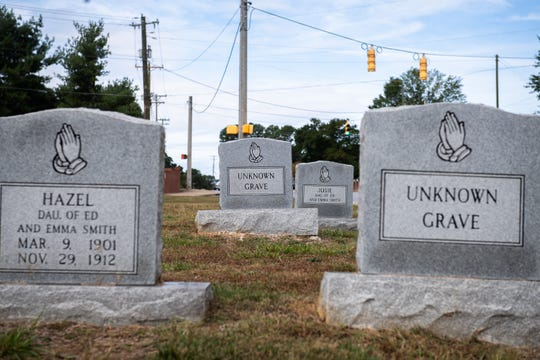 In 1933, a man was lynched and buried in the cemetery at Enoree Fork Baptist Church in Greer. While his exact burial location is unknown, it may be marked by unidentified headstones like these.