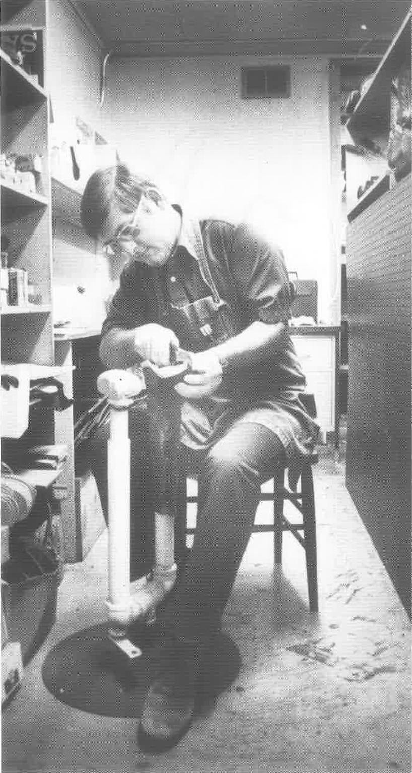 Dennis Siller working at Siller's Boot and Shoe Repair in Great Falls on August, 17, 1981