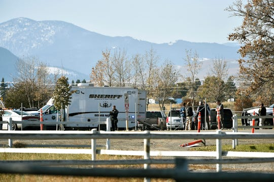 The Lewis and Clark County bomb squad works the scene at Rossiter Elementary School.