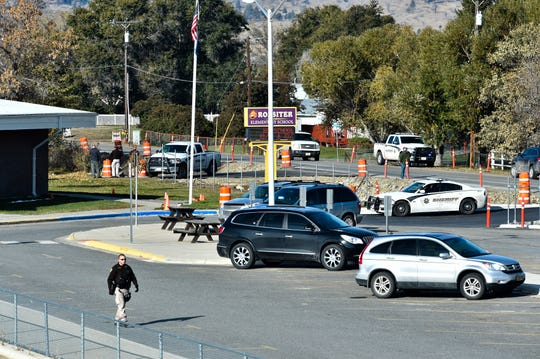 The Lewis and Clark County bomb squad works the scene at Rossiter Elementary School Tuesday.