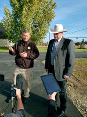 Lewis and Clark County Undersheriff Jason Grimmis, left, and Sheriff Leo Dutton, right, update reporters on a homemade bomb that detonated in an elementary school playground on Tuesday.