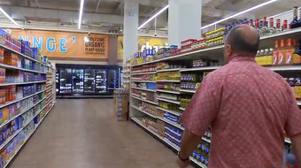 Pay-Less Supermarkets General Manager Mike Benito gives a tour of the new Maite location before the store's grand opening, Oct. 15, 2019.