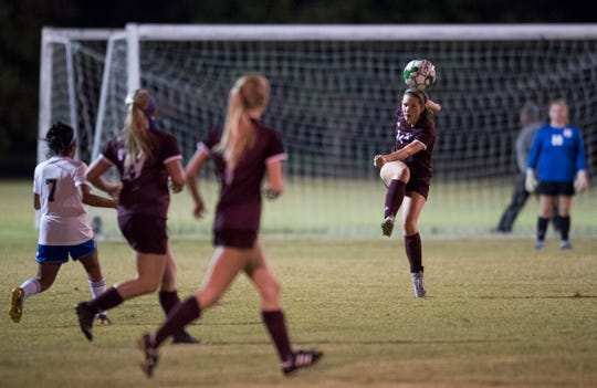Henderson County's Kayla Wayne (14) passes the ball during the first round of the Girls Second Region Soccer Tournament against the Caldwell County Lady Tigers in Hopkinsville, Ky., Monday evening, Oct. 14, 2019.