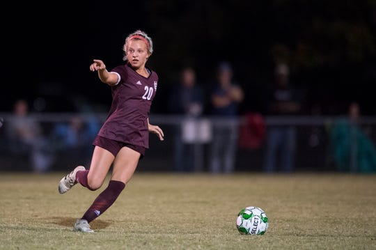 Henderson County's Morgan Green (20) points to a teammate during the first round of the Girls Second Region Soccer Tournament against the Caldwell County Lady Tigers in Hopkinsville, Ky., Monday evening, Oct. 14, 2019.