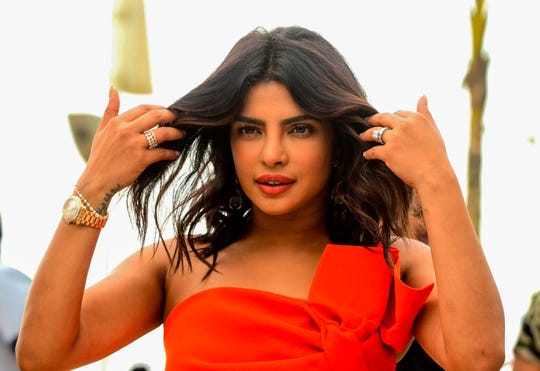 "Priyanka Chopra gestures as she poses for photographs during the promotion of the upcoming biographical Hindi film ""The Sky Is Pink"" on Sept. 26, 2019, in Mumbai."