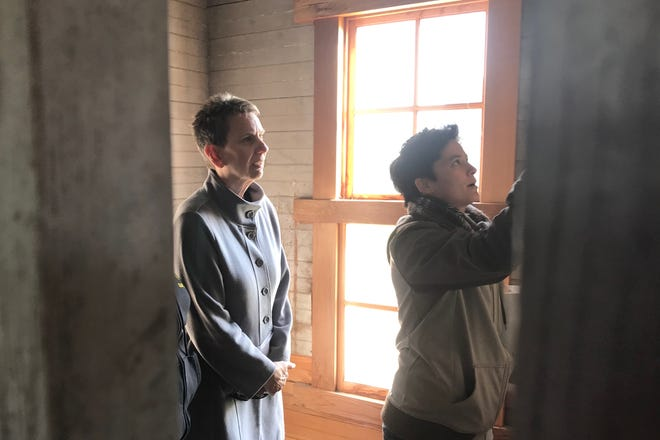 Johnson County Supervisor Pat Heiden and V Fixmer-Oraiz of Astig Planning LLC peer to look at the etchings on the walls of the asylum at the Johnson County Historic Poor Farm on Tuesday, October 15, 2019.