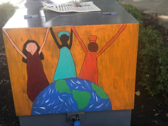 Nine-year old Ava Ingle painted an American girl, an African girl and a Mexican girl on the electrical box at the corner of E. Main St. and Liberty St. as part of Mayor Scott Conger's Public Art Initiative.