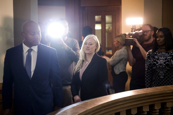 Kristine Barnett, center, is followed by news cameras as she walks out of Superior 2 with her attorney, Philip Hayes, Tuesday, Oct. 15, 2019 at the Tippecanoe County Courthouse in Lafayette. Barnett and her ex-husband, Michael Barnett, are accused of abandoning their adoptive daughter in Lafayette in 2013.