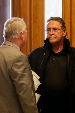 Walter Kenneth Baldwin, right, pauses to talk with his attorney Michael Troemel, left, outside Superior 5 after pleading guilty in the 2018 killing of a caged cat at his mobile home park on U.S. 52, Tuesday, Oct. 15, 2019 at the Tippecanoe County Courthouse in Lafayette. Baldwin pleaded guilty to conspiracy to torture or mutilate a vertebrate animal, torture or mutilating a vertebrate animal, conspiracy to killing a domestic animal and killing a domestic animal.
