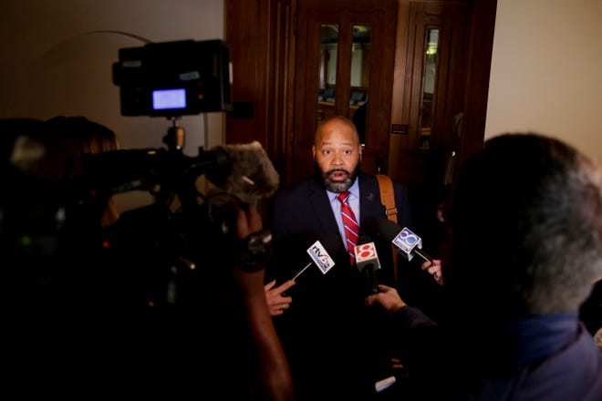 Michael Barnett's attorney, Terrance Kinnard, answers questions from the media after appearing in Superior 2, Tuesday, Oct. 15, 2019 at the Tippecanoe County Courthouse in Lafayette. Barnett and his ex-wife, Kristine Barnett, are accused of abandoning their adoptive daughter in Lafayette in 2013.