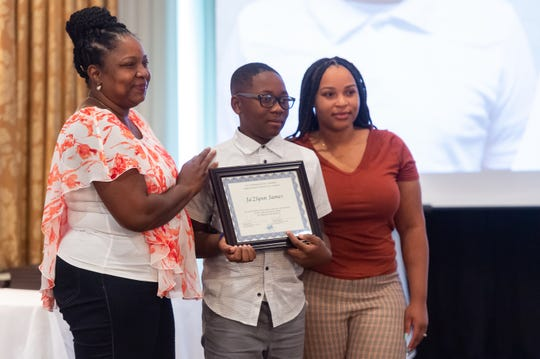 Ja'Zlynn James is awarded at the Cox Inspirational Heroes ceremony honoring 27 children from throughout Acadiana who have overcome incredible obstacles on Tuesday, Oct. 15, 2019.
