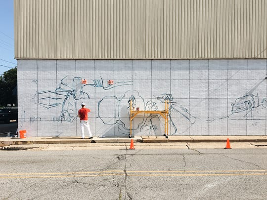 Dirk Guidry, a local abstract artist, went from eating Evangeline Maid Bread sandwiches as a kid to creating the company's centennial mural.
