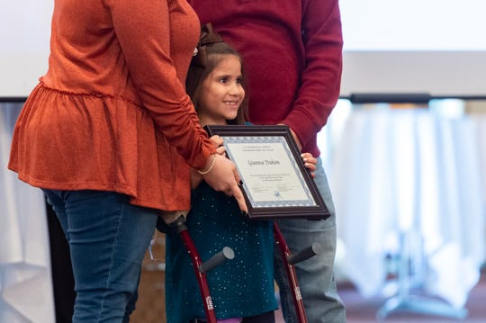 Gianna Duhon is awarded at the Cox Inspirational Heroes ceremony honoring 27 children from throughout Acadiana who have overcome incredible obstacles on Tuesday, Oct. 15, 2019.
