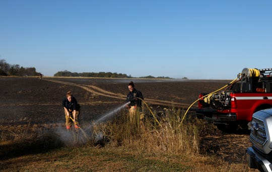 Berne Township firefighters put out an isolated patch of smoldering brush Tuesday afternoon, Oct. 15, 2019, in the 6200 block of Crumley Road in Amanda Township. Firefighters from seven county fire departments responded to the field fire which burned seven to eight acres before it was brought under control. The fire was started by a resident burning brush near the field and the fire spreading to engulf the acreage.