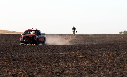 Firefighters from seven county fire departments responded to the field fire Tuesday afternoon, Oct. 15, 2019, in the 6200 block of Crumley Road in Amanda Township. The fire burned seven to eight acres before it was brought under control. It was started by a resident burning brush near the field and the fire spreading to engulf the acreage.