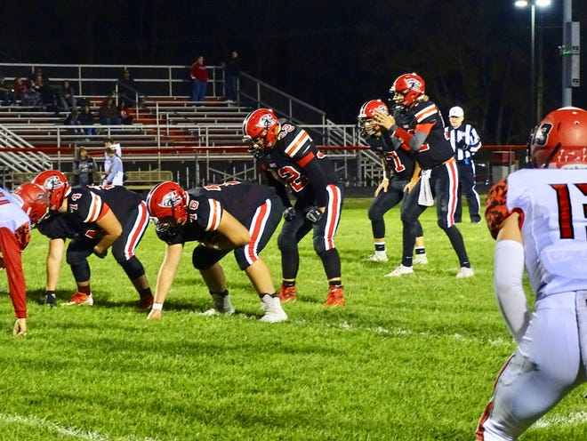 Fairfield Union quarterback Blayde Patton looks over the Logan Elm defense before getting the snap. Patton scored the Falcons' lone touchdown in a 27-7 loss to the Braves Monday night.