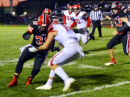 Fairfield running back Nate Schmelzer blocks a Logan Elm defender during the Falcons' 27-7 loss Monday night.