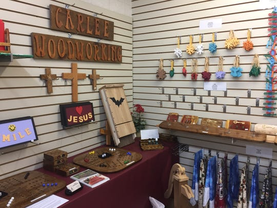 Handmade games, ornaments and other products are for sale at the D-19 Flea Market in Putnam Township on Friday, Oct. 11, 2019.
