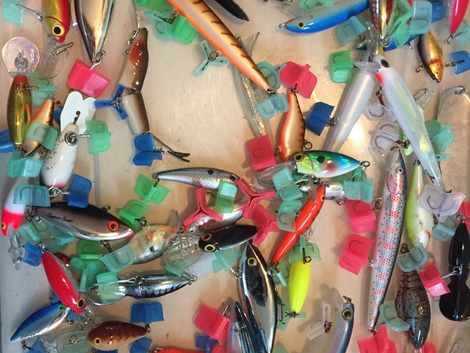 State health officials warn that PFAS contamination in the Huron River and connected lakes, creeks and ponds poses a health risk to swimmers and people who fish. Pictured, a box of fishing lures for sale at the D-19 Flea Market in Putnam Township on Friday, Oct. 11, 2019.
