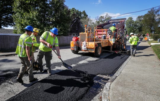 Crews work along a street in the Deer Park neighborhood in the Highlands to repair the area where Google Fiber was installed.