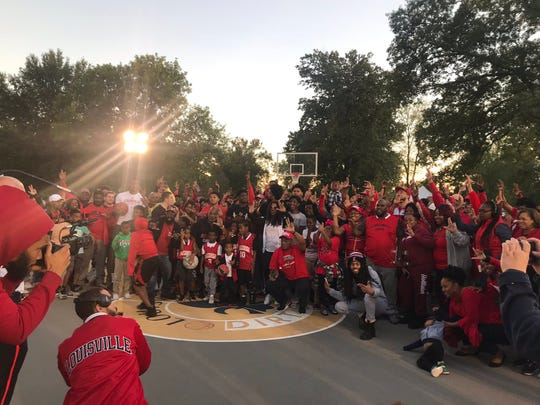 Louisville fans joined several Cardinal basketball players on the court at Shawnee Park's Dirt Bowl on Monday for a video shoot. Oct. 14, 2019