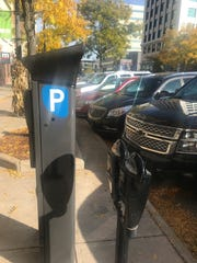 Kiosks, pictured here on Washtenaw Street in downtown Lansing, will allow drivers to pay for parking using a mobile application.