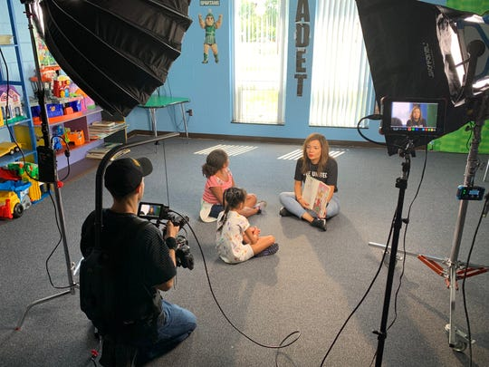 Lucianna Solis reads to kids at the Lansing Boys and Girls Club as part of a video made for the Capital Area United Way, which celebrates its 100-year anniversary Oct. 19, 2019.