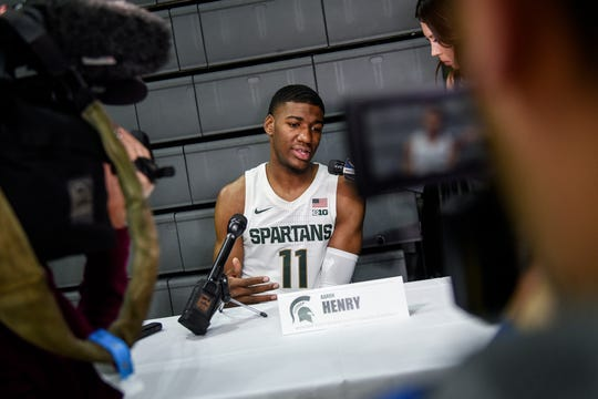 Aaron Henry talks with reporters during media day Tuesday at the Breslin Center.
