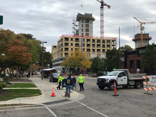 The East Lansing Fire Department has closed roads around the Park District project after a concrete form tipped.
